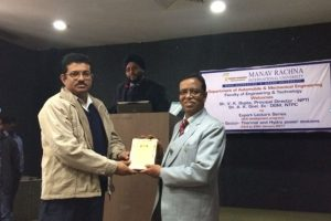 Dr. Devendra Vashist felicitating Mr. V.K.Gupta