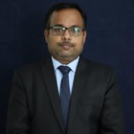 Dr. Dinesh Tripathi